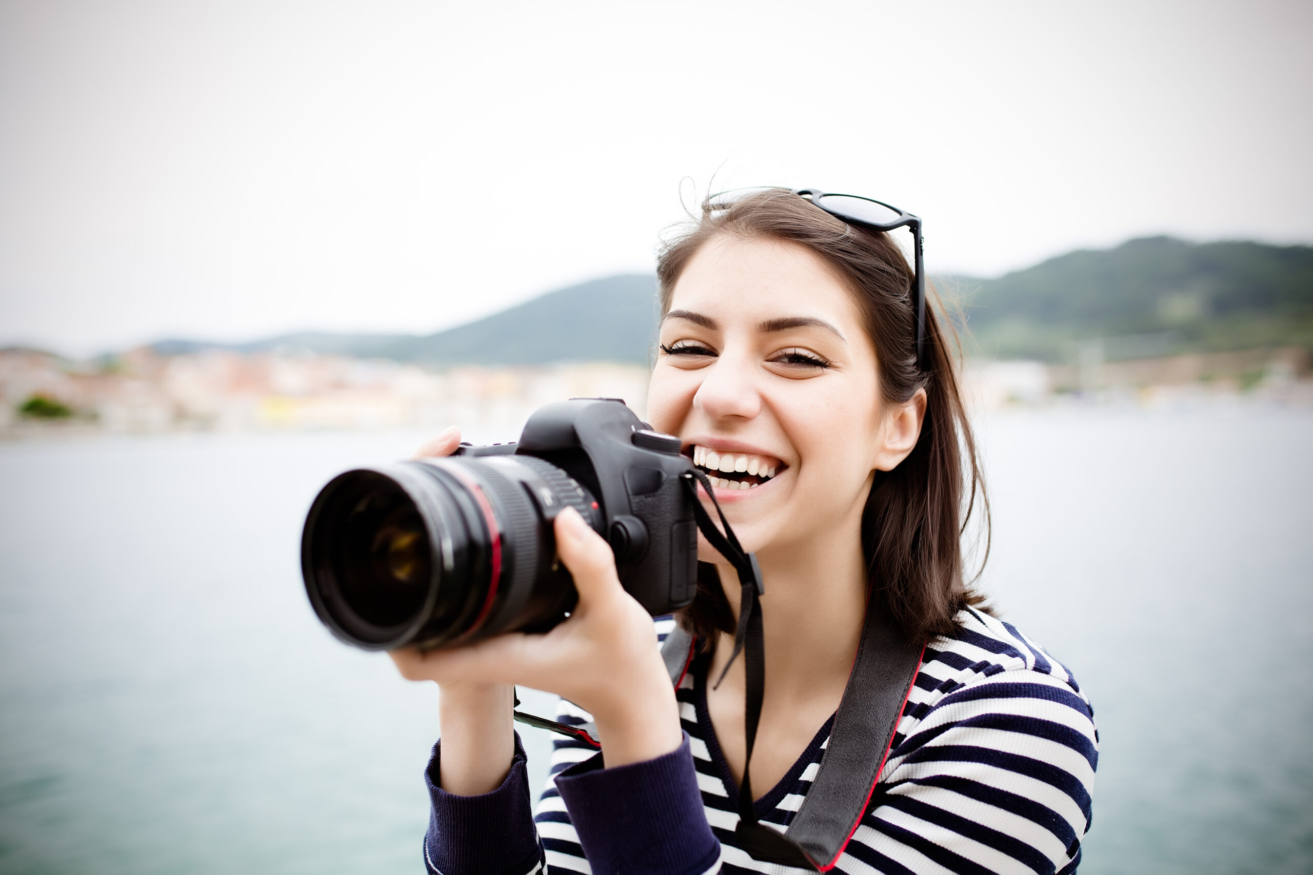 Happy,Woman,On,Vacation,Photographing,With,A,Dslr,Camera,On